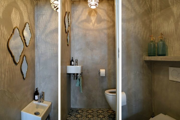 Toilet met pandomo op de muur